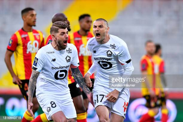Burak Yilmaz of Lille OSC reacts after scoring a penalty during the Ligue 1 match between RC Lens and Lille OSC at Stade Bollaert-Delelis on May 07,...