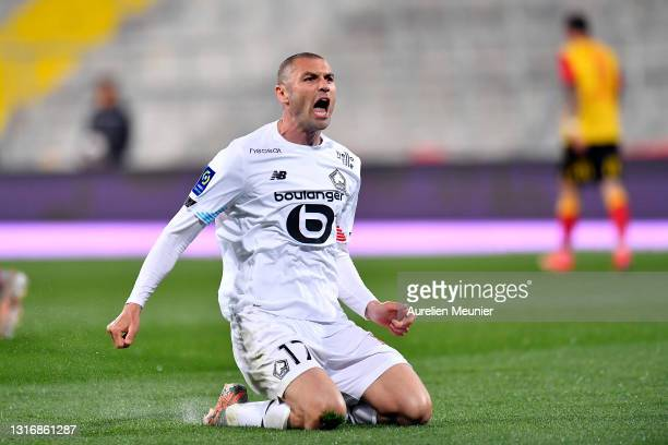Burak Yilmaz of Lille OSC reacts after scoring his second goal during the Ligue 1 match between RC Lens and Lille OSC at Stade Bollaert-Delelis on...