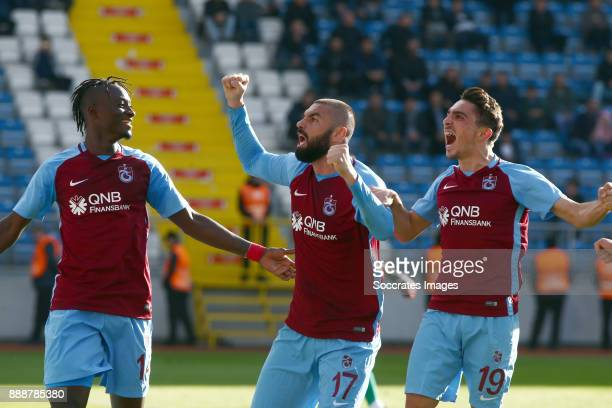 Burak Yilmaz of Trabzonspor celebrates 10 with Dame N Doye of Trabzonspor Abdulkadir Omur of Trabzonspor during the Turkish Super lig match between...