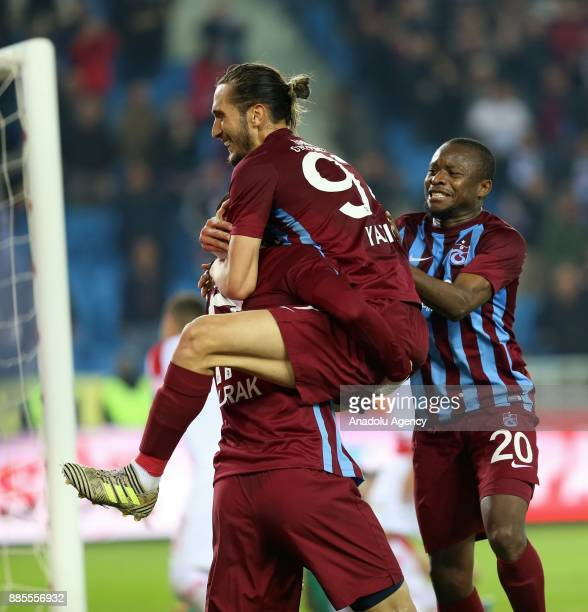 Burak Yilmaz of Trabzonspor celebrates with his team mates after scoring during a Turkish Super Lig match between Trabzonspor and Antalyaspor at...