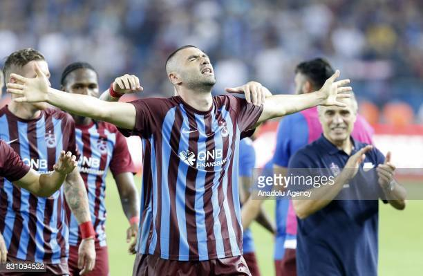Burak Yilmaz of Trabzonspor celebrates with his teammates after scoring a goal during a Turkish Spor Toto Super Lig soccer match between Trabzonspor...