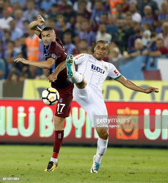 Burak Yilmaz of Trabzonspor in action against Souza Silva of Aytemiz Alanyaspor during the Turkish Super Lig week 6 soccer match between Trabzonspor...
