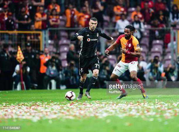 Burak Ylmaz of Besiktas and Semih Kaya of Galatasaray challenging for the ball during the Turkish Super Lig match between Galatasaray SK and Besiktas...