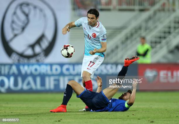 Burak Ylmaz of Turkey vies with Enis Alushi of Kosova during the FIFA 2018 World Cup Qualifiers Group I match between Kosovo and Turkey at Loro...