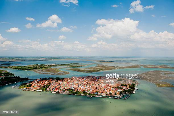 island with colorfully painted houses in the lagoon of Venice Wellknown for its lacework it is only accessible by boat