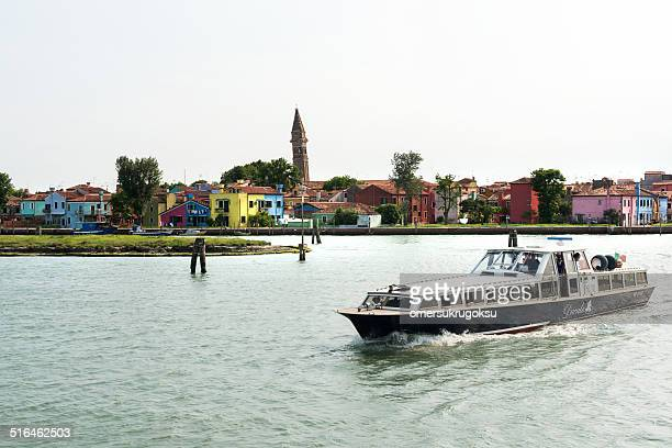 burano island with vaporetto - vaporetto stock photos and pictures