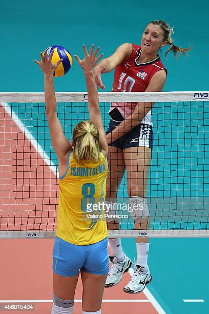 Burbach Jordan Larson of USA smashes as Korinna Ishimtseva of Kazakhstan blocks during the FIVB Women's World Championship pool C match between...