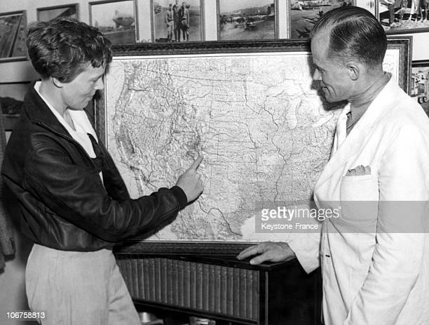 Burbank Before Her Air Raid The Aviatrix Amelia Earhart Glances Over A Relief Map Of The United States In August 1935