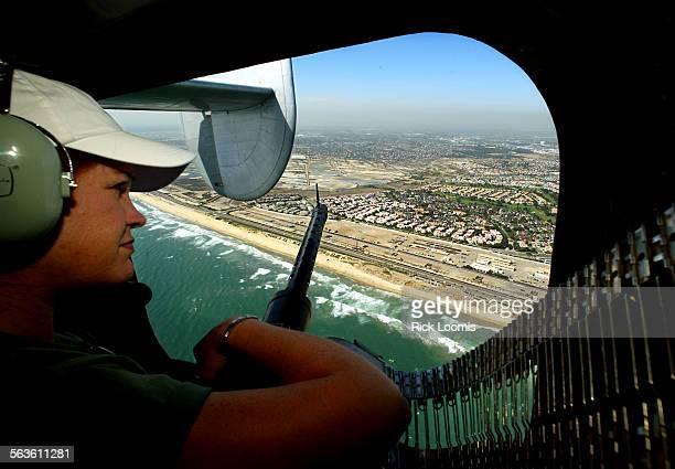 Burbank Santa Ana––Liz Minichino of Placerville Ca views the Orange County coastline from the machine gun window of the only B–24 Liberator still...