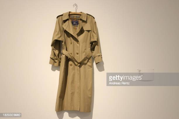 Burberry coat from the 90's is seen during the exhibition Dress Code: Are You Playing Fashion? - A collection of The Kyoto Costume Institute at...