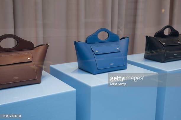 Burberry handbags in their shop window on 5th March 2021 in London, England, United Kingdom. Burberry is a British luxury fashion house headquartered...