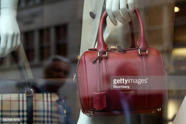 A Burberry logo sits on a red handbag displayed in the window of a Burberry fashion store operated by Burberry Group Plc on New Bond Street in London...