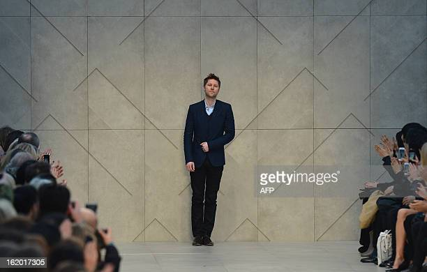 Burberry's chief creative officer Christopher Bailey greets the audience at the end of the Burberry Prorsum catwalk show during the 2013...
