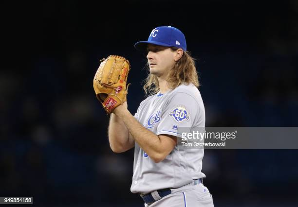 Burch Smith of the Kansas City Royals looks in before delivering a pitch in the eighth inning during MLB game action against the Toronto Blue Jays at...
