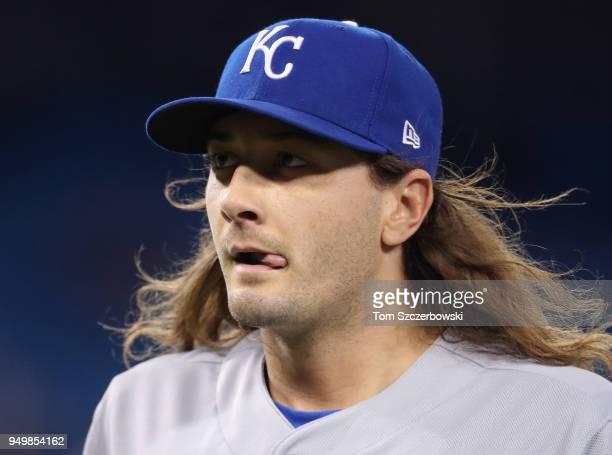 Burch Smith of the Kansas City Royals walks back to his dugout after retiring the side in the eighth inning during MLB game action against the...