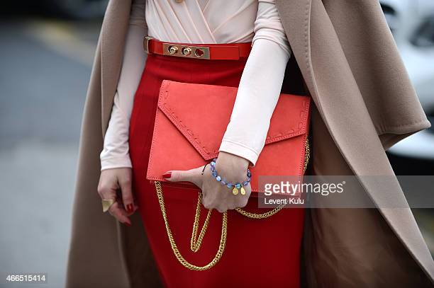 Burcin Unaldi poses wearing a dress by Gulnur Gunes and a hang bag by Chuchu during Mercedes Benz Fashion Week Istanbul FW15 on March 16 2015 in...