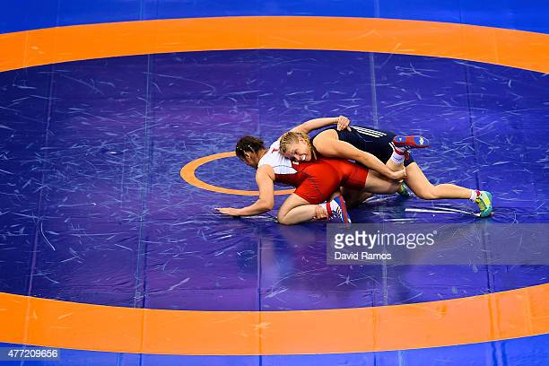 Burcu Orskaya Ugduler of Turkey and Aline Focken of Germany compete in the Women's wrestling 69kg Freestyle 1/8 Final match during day three of the...