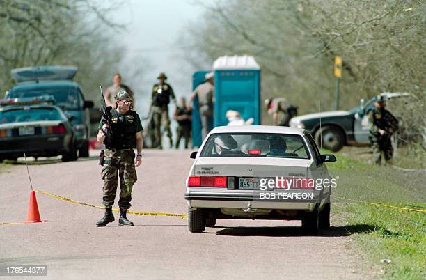 A Bureau of Alcohol Tobacco and Firearms agent confronts sightseers on March 08 1993 at a checkpoint near the Branch Davidian religious compound in...