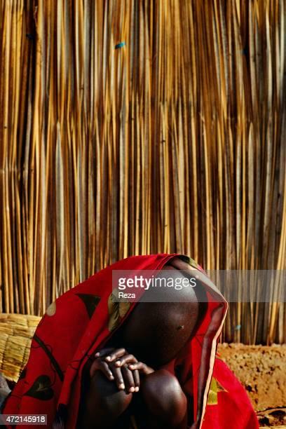 Burengue Camp Lake Cyohoha Rwanda An exhausted Hutu Burundian refugee boy gets rest