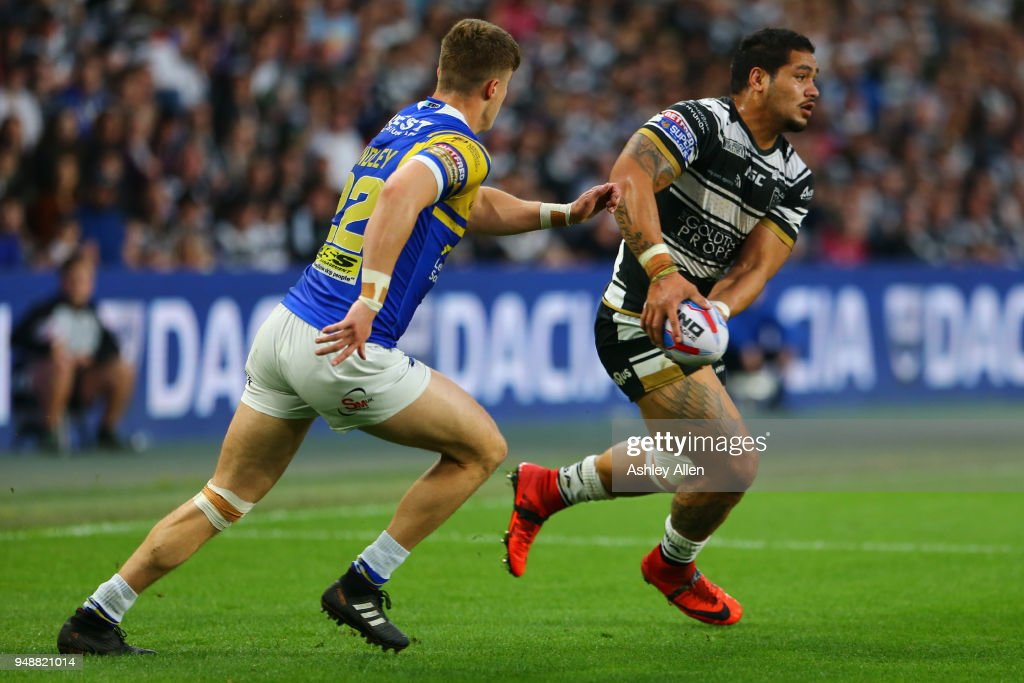 Bureta Faraimo of Hull FC (R) runs with the ball as Ash Handley (L) of Leeds Rhinos chases him down during the BetFred Super League match between Hull FC and Leeds Rhinos at the KCOM Stadium on April 19, 2018 in Hull, England.