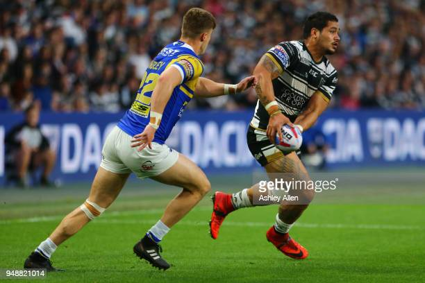 Bureta Faraimo of Hull FC runs with the ball as Ash Handley of Leeds Rhinos chases him down during the BetFred Super League match between Hull FC and...
