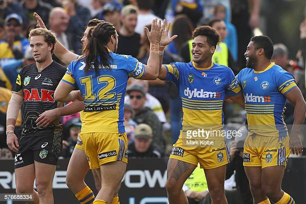 Bureta Faraimo of the Eels celebrates with his team mates after scoring a try during the round 19 NRL match between the Penrith Panthers and the...