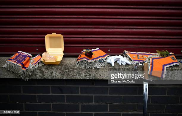 A burger a sword and several Orange sashes sit on a wall as the annual 12th of July Orange march and demonstration takes place on July 12 2018 in...