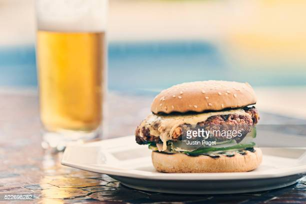 Burger and beer by poolside