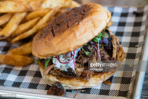 a burger and fish and chips on the table - cambridge new zealand stock pictures, royalty-free photos & images