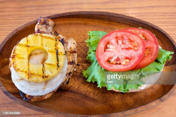 burger assembly, hawaiian teriyaki, grilled pineapple, chicken, onion, melting cheese, crispy vegetable and sweet tomato - turkey burger stock pictures, royalty-free photos & images