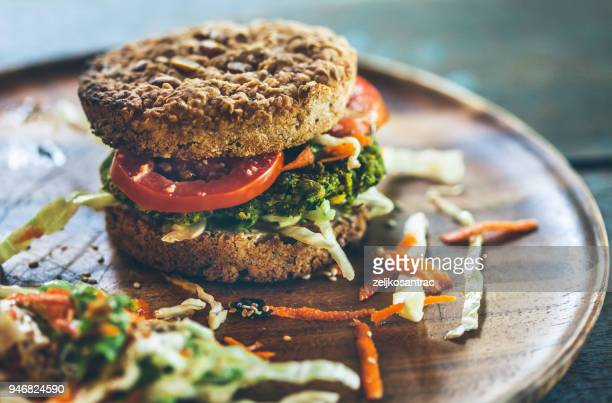 burger for vegetarians. burger with falafel. - veganism stock pictures, royalty-free photos & images