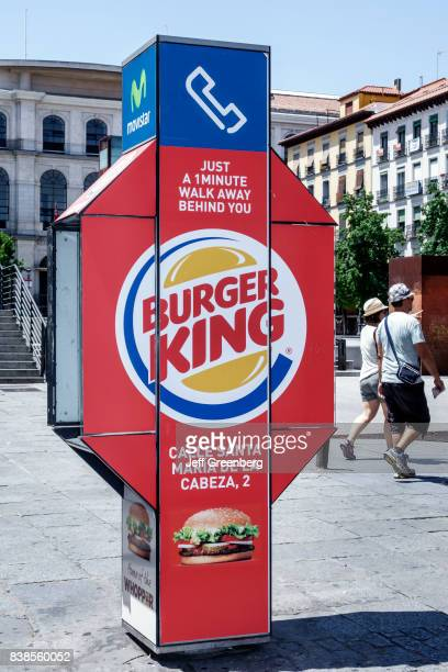 A Burger King advertisement on the side of public phone in Atocha