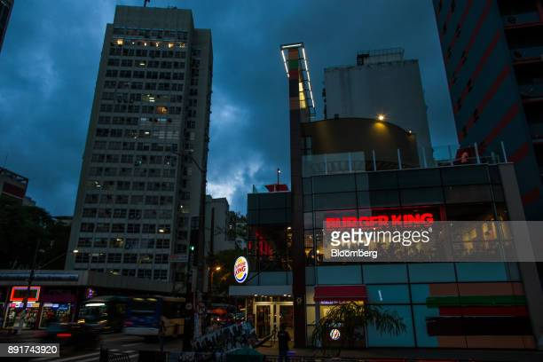 A Burger King do Brasil restaurant stands illuminated at night on Paulista Avenue in Sao Paulo Brazil on Monday Dec 11 2017 Burger King do Brasil may...