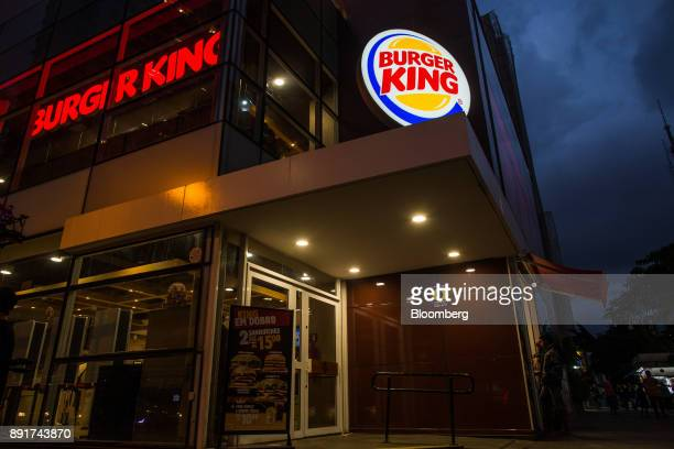 Burger King do Brasil signage stands illuminated at night outside a restaurant on Paulista Avenue in Sao Paulo, Brazil, on Monday, Dec. 11, 2017....