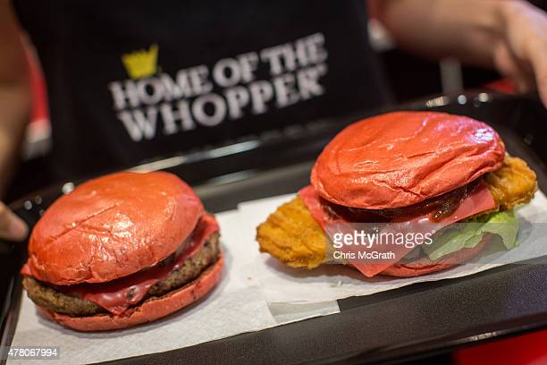 Burger King employee shows off the new 'Red' burgers at a store on June 22 2015 in Tokyo Japan The AKA Samurai Burger and the Samurai Chicken Burger...