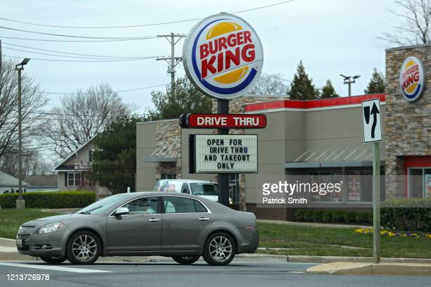 Burger King restaurant displays a sign reading 'Open for Drive Thru and Takeout Only' amid the coronavirus outbreak on March 18, 2020 in Mount Airy,...