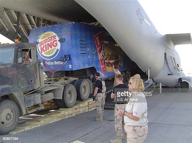 Burger King trailer is unloaded from a C17 Globemaster III aircraft May 19 2004 at Bagram Airbase Afghanistan The restaurant which should be...