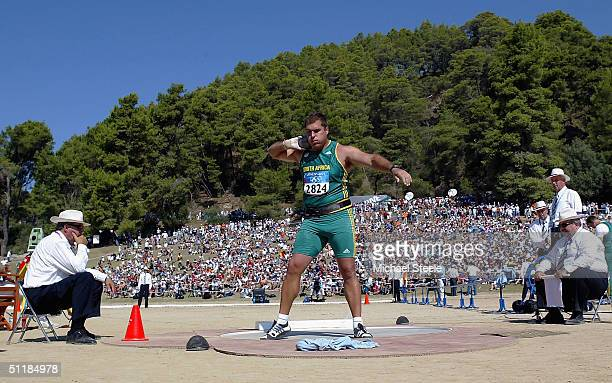 Burger Lanbrechts of South Africa prepares to make his toss in the men's shot put qualifying round on August 18, 2004 during the Athens 2004 Summer...
