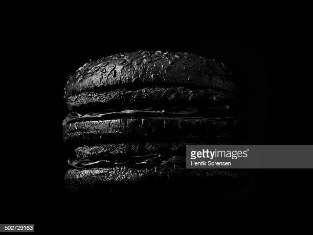 Burger on black backdrop
