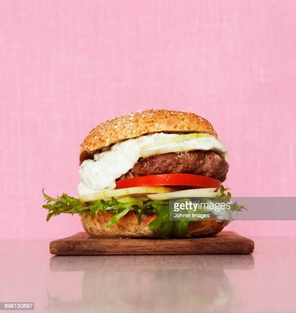 Burger on pink background