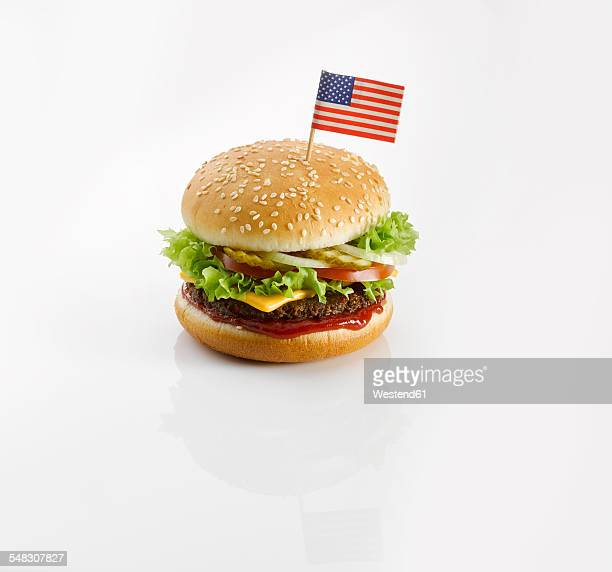 burger with american flag - cheeseburger stock pictures, royalty-free photos & images