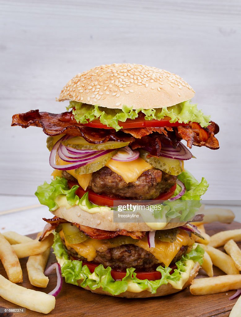 Burger With Beef, Bacon, Tomato, Cheese, Lettuce and Onion : Stock Photo
