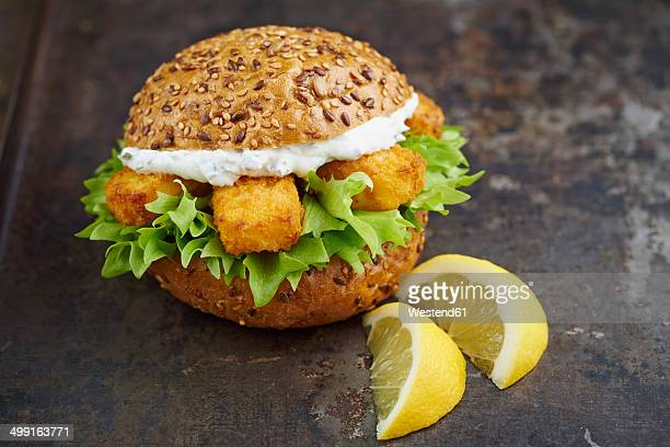 Burger with fish fingers and herb curd
