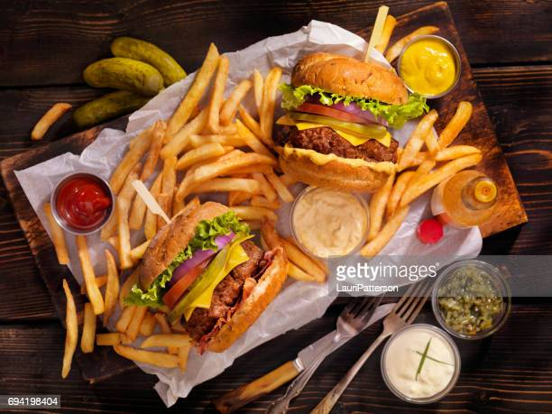 burgers and fries - hamburger stock pictures, royalty-free photos & images