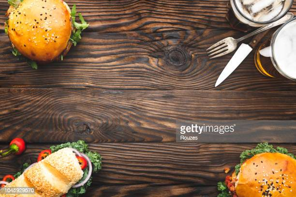 burgers and sandwich with light beer - menu stock pictures, royalty-free photos & images