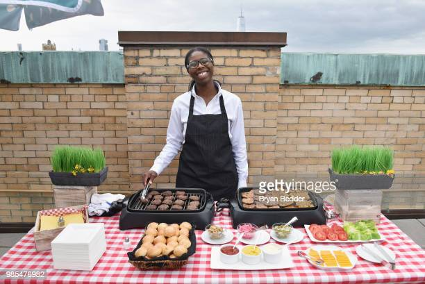 Burgers are served during the DSW Block Party hosted by Olympians Adam Rippon and Mirai Nagasu on June 27 2018 at Ramscale Studio in New York City
