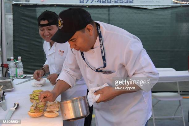 Burgers from Burger and Barrel being made at the Food Network Cooking Channel New York City Wine Food Festival Presented By CocaCola Blue Moon Burger...