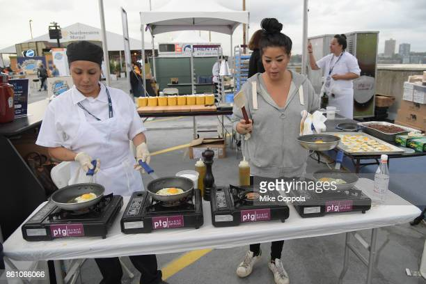 Burgers from The Beatrice Inn being made at the Food Network Cooking Channel New York City Wine Food Festival Presented By CocaCola Blue Moon Burger...