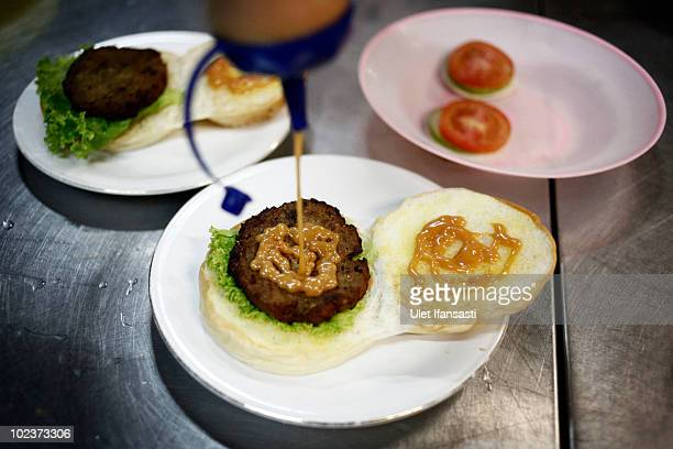 Burgers made from cobra snakes are ready to be served on June 24 2010 in Yogyakarta Indonesia The snakes are caught and processed into burgers which...
