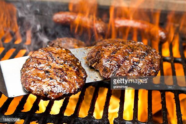 Burgers on Grill with Bratwurst and Flames